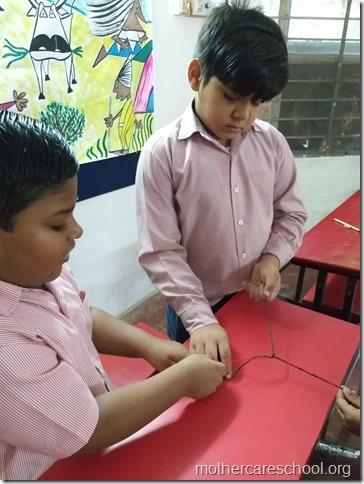 With handmade pom pom rakhis.. (1)